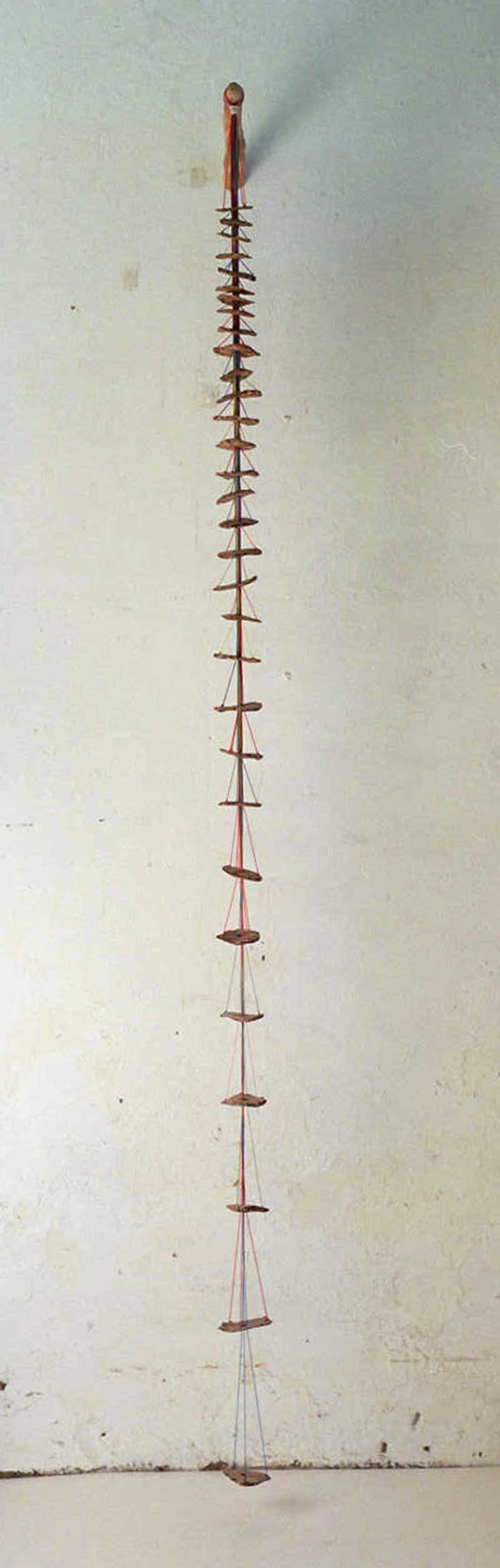 Hanging 2 (Fired ceramic with cotton thread and wood 20x80x9cms)