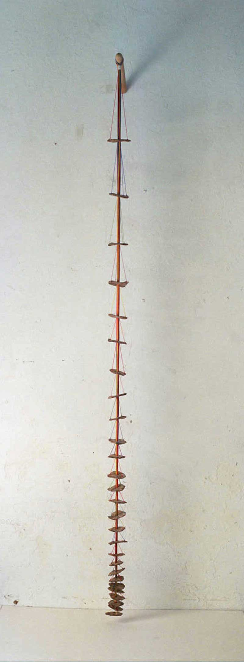Hanging 3 (Fired ceramic with cotton thread and wood 20x80x9cms)