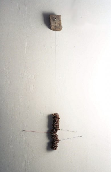 Hanging 4 (Fired ceramic with cotton, stone and wire 20x80x9cms)