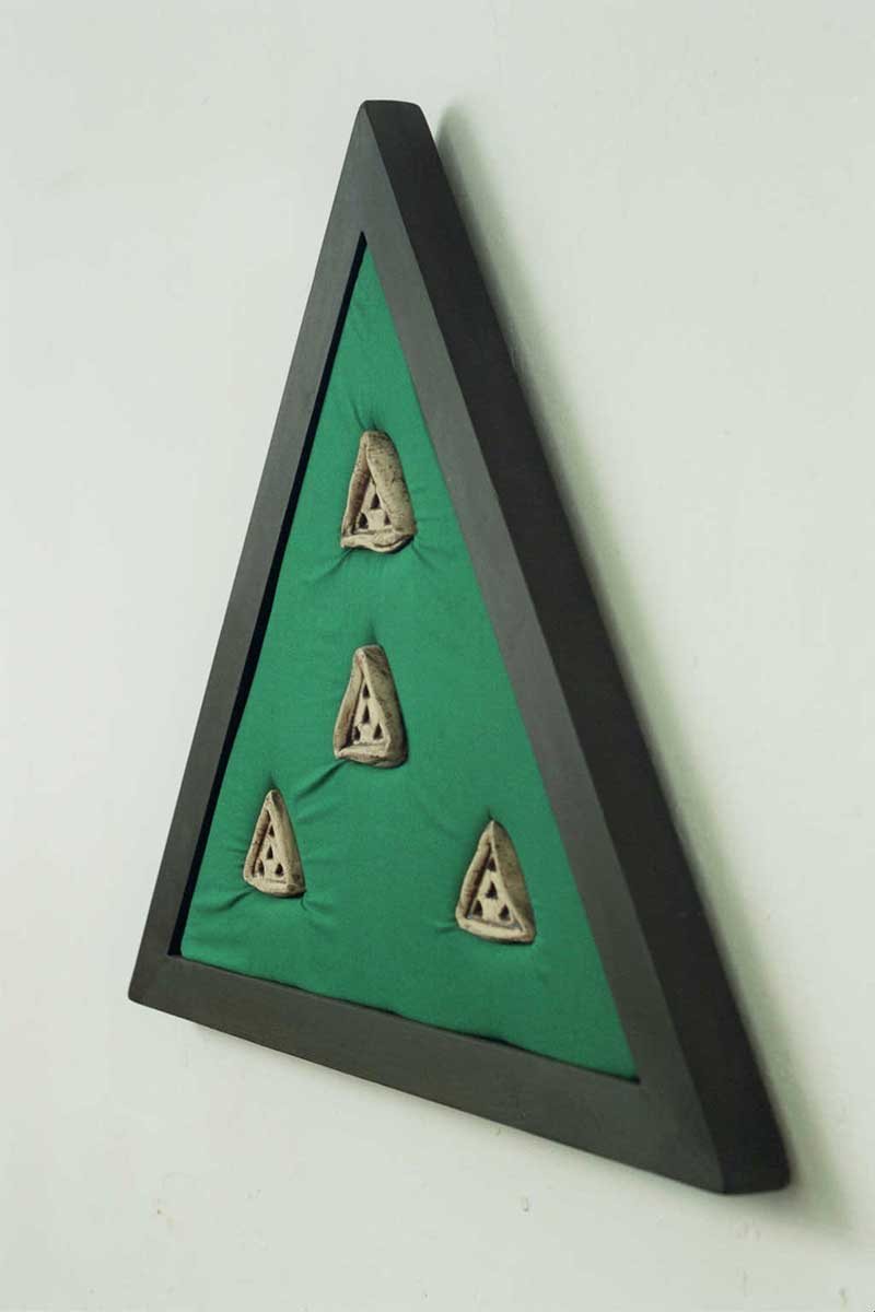 Institution Triangle (fired clay on fabric 74×65x5cms)