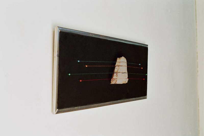 Horizontal Slice (fired ceramic with cotton thread on fabric 70x40x10cms)