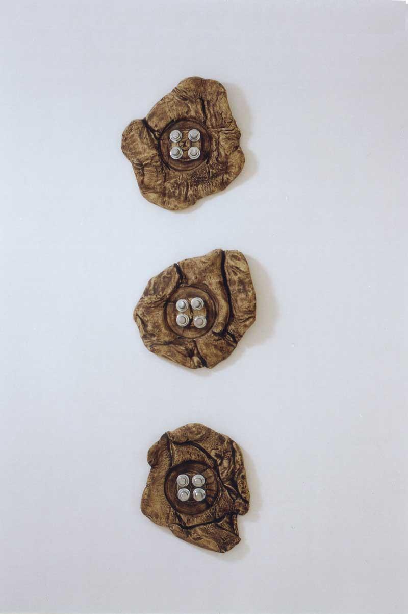 BoltButtons (fired ceramic with woollen thread, each piece 36cms diam)