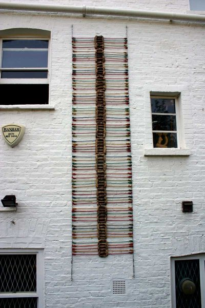Centipede+40 (fired ceramic with sash and chain 600x150x10cms)