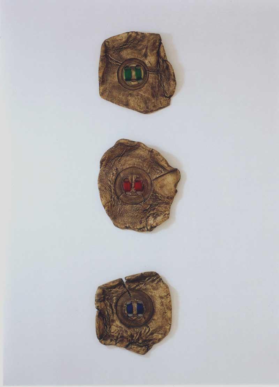 Wool Buttons (fired ceramic with woollen thread, each piece 36cms diam)